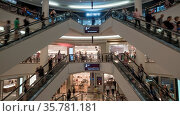 People riding up and down escalators in modern multistorey trade ... Стоковое фото, фотограф Zoonar.com/Danil Roudenko / age Fotostock / Фотобанк Лори