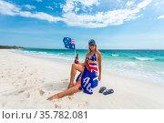 True blue fair dinkum Aussie girl laid back on the beach, waving ... Стоковое фото, фотограф Zoonar.com/Leah-Anne Thompson / age Fotostock / Фотобанк Лори