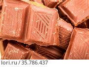 Broken Milk Chocolate Bar, Chocolate Bar Taken Closeup As Food Background... Стоковое фото, фотограф Zoonar.com/Alex Varlakov / age Fotostock / Фотобанк Лори