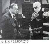 The Invisible Man', 1933. Claude Rains orders the help of William Harrigan to do his will. Rains made his picture debut in a film in which his face was never shown. Редакционное фото, агентство World History Archive / Фотобанк Лори