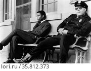 In the Heat of the Night is a 1967 dramatic mystery film directed by Norman Jewison. It is based on the 1965 John Ball novel; tells the story of Virgil Tibbs; a black police detective from Philadelphia; who becomes involved in a murder investigation in a racist small town in Mississippi. It stars Sidney Poitier; Rod Steiger; and Warren Oates. Редакционное фото, агентство World History Archive / Фотобанк Лори