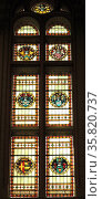 Stained glass window at the Rijksmuseum, Amsterdam, Holland. Depicts various heraldic shields and emblems. Редакционное фото, агентство World History Archive / Фотобанк Лори