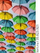 Multi-color umbrella display hanging high over a street in Jerusalem, Israel. Стоковое фото, фотограф Наталья Волкова / Фотобанк Лори