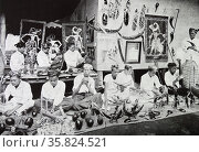 Indonesian group making toys and decoratives. Редакционное фото, агентство World History Archive / Фотобанк Лори