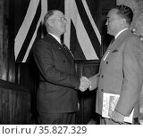 J. Edgar Hoover, (right) Director of The Federal Bureau of Investigation, is greeted by Arthur Muchow, President of the International Association for Identification, Редакционное фото, агентство World History Archive / Фотобанк Лори