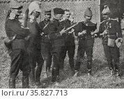 French officers study maps before action in the frontier with Belgium. 19140101 World War I 19140101. Редакционное фото, агентство World History Archive / Фотобанк Лори