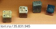 Six loom-weights, three disc-shaped and three cubes Minoan, 2100-1450 B.C. Редакционное фото, агентство World History Archive / Фотобанк Лори
