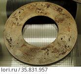 Two jade disc, bi Shang dynasty, 12th-11th century BC. Редакционное фото, агентство World History Archive / Фотобанк Лори