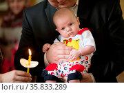 Belarus, Gomel, May 6, 2018. Church of Volotovo. Baptism of a newborn... Стоковое фото, фотограф Zoonar.com/Svetlana / age Fotostock / Фотобанк Лори