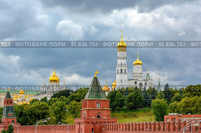 Walls and gardens of the Kremelin in Moscow in Russia with its churches...