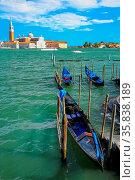 Gondolas moored near San Marco square across from San Giorgio Maggiore... Стоковое фото, фотограф Zoonar.com/Don Mammoser / age Fotostock / Фотобанк Лори