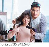 Man stylist working with woman in beauty salon. Стоковое фото, фотограф Elnur / Фотобанк Лори