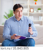 Funny man singing songs in karaoke at home. Стоковое фото, фотограф Elnur / Фотобанк Лори