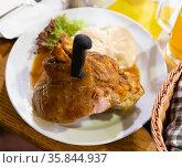 Fried pork knuckle with mustard and horseradish. Traditional czech dish. Стоковое фото, фотограф Яков Филимонов / Фотобанк Лори