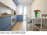 Cozy modern kitchen interior, some drawers pulled out. Стоковое фото, фотограф Сергей Старуш / Фотобанк Лори