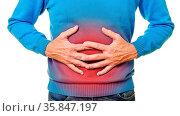 Mann mit Magenschmerzen hält Hände auf seinen Bauch. Стоковое фото, фотограф Zoonar.com/Robert Kneschke / age Fotostock / Фотобанк Лори