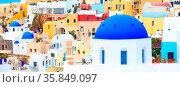 Oia, Santorini - April 25, 2019: Famous village in cyclades Island... Стоковое фото, фотограф Zoonar.com/Nataliya_Nazarova{} / age Fotostock / Фотобанк Лори