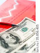 Finance background with money, stock market chart, graph and pen.... Стоковое фото, фотограф Zoonar.com/BASHTA / easy Fotostock / Фотобанк Лори