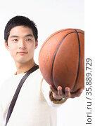Young Asian man. Стоковое фото, агентство Ingram Publishing / Фотобанк Лори