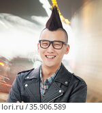 Young man with punk Mohawk smiling. Стоковое фото, агентство Ingram Publishing / Фотобанк Лори