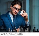 Businessman playing chess in strategy concept. Стоковое фото, фотограф Elnur / Фотобанк Лори