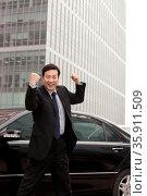 Businessman expressing enthusiasm. Стоковое фото, агентство Ingram Publishing / Фотобанк Лори