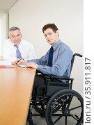 Disabled male office worker. Стоковое фото, фотограф Shannon Fagan / Ingram Publishing / Фотобанк Лори