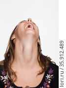 Portrait of young woman with her head back laughing. Стоковое фото, фотограф Shannon Fagan / Ingram Publishing / Фотобанк Лори