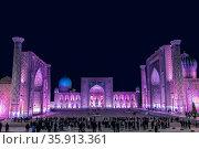 Uzbekistan. View of Registan square in Samarkand with Ulugbek madrasah, Sherdor madrasah and Tillya-Kari madrasah at night with lilac color backlight. (2019 год). Стоковое фото, фотограф Наталья Волкова / Фотобанк Лори