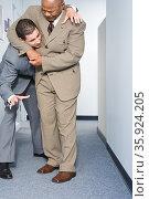 Businessmen fighting. Стоковое фото, фотограф Shannon Fagan / Ingram Publishing / Фотобанк Лори