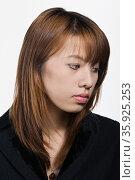 Portrait of young adult Asian woman. Стоковое фото, фотограф Shannon Fagan / Ingram Publishing / Фотобанк Лори