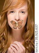 Butterfly covering woman's mouth. Стоковое фото, фотограф Shannon Fagan / Ingram Publishing / Фотобанк Лори