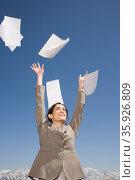 Woman throwing paper. Стоковое фото, фотограф Shannon Fagan / Ingram Publishing / Фотобанк Лори