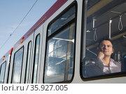 Man on light rail. Стоковое фото, фотограф Shannon Fagan / Ingram Publishing / Фотобанк Лори