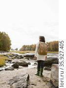 Mature hiker walking over rocks. Стоковое фото, фотограф Shannon Fagan / Ingram Publishing / Фотобанк Лори
