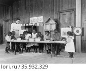 Eight African American children, in kindergarten, learning washing and ironing at Whittier Primary School, Hampton, Virginia. Редакционное фото, агентство World History Archive / Фотобанк Лори