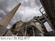 Outside of coal powered power station looking up at smoke stack. Liddell Power Station, Musswellbrook, NSW, Australia. July 2018. Стоковое фото, фотограф Doug Gimesy / Nature Picture Library / Фотобанк Лори
