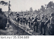 Photograph of the German infantry across the Belgian boarder during World War One. Редакционное фото, агентство World History Archive / Фотобанк Лори