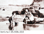 Young boys paly in a tidal pool on an English beach 1928. Редакционное фото, агентство World History Archive / Фотобанк Лори