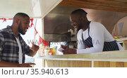 African american man wearing apron ordering food at the food truck. Стоковое видео, агентство Wavebreak Media / Фотобанк Лори