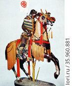 Model of a Japanese Samurai Warrior in full armour on horseback. Редакционное фото, агентство World History Archive / Фотобанк Лори