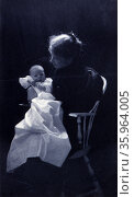 Woman, sitting in chair, holding an infant by Sarah Jane Eddy, 1851-1945, photographer. Редакционное фото, агентство World History Archive / Фотобанк Лори