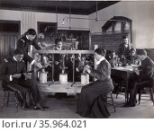 The cheese press screw - students studying agricultural sciences, Hampton Institute, Hampton, Virginia. 1900. Редакционное фото, агентство World History Archive / Фотобанк Лори