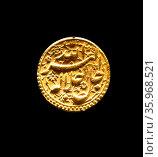 Gold Mughal coin of Emperor Akbar, Agra 1556-1605. Редакционное фото, агентство World History Archive / Фотобанк Лори