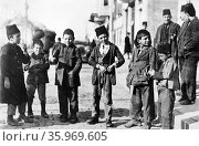 Photograph of children of different ethnic groups in a street, Ottoman Turkey. Редакционное фото, агентство World History Archive / Фотобанк Лори