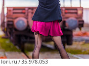Teen girl twisted seamed nylon stockings rearview cropped body show. Стоковое фото, фотограф Emil Pozar / age Fotostock / Фотобанк Лори