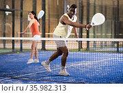 Padel tennis player posing in court closeup. Стоковое фото, фотограф Яков Филимонов / Фотобанк Лори