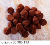 Dessert truffles sprinkled with cocoa on wooden table. Стоковое фото, фотограф Яков Филимонов / Фотобанк Лори