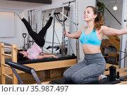 Pilates exercises on machines in health club. Стоковое фото, фотограф Яков Филимонов / Фотобанк Лори