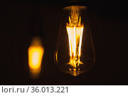 Tungsten lamps glow in the dark, close-up photo. Стоковое фото, фотограф EugeneSergeev / Фотобанк Лори